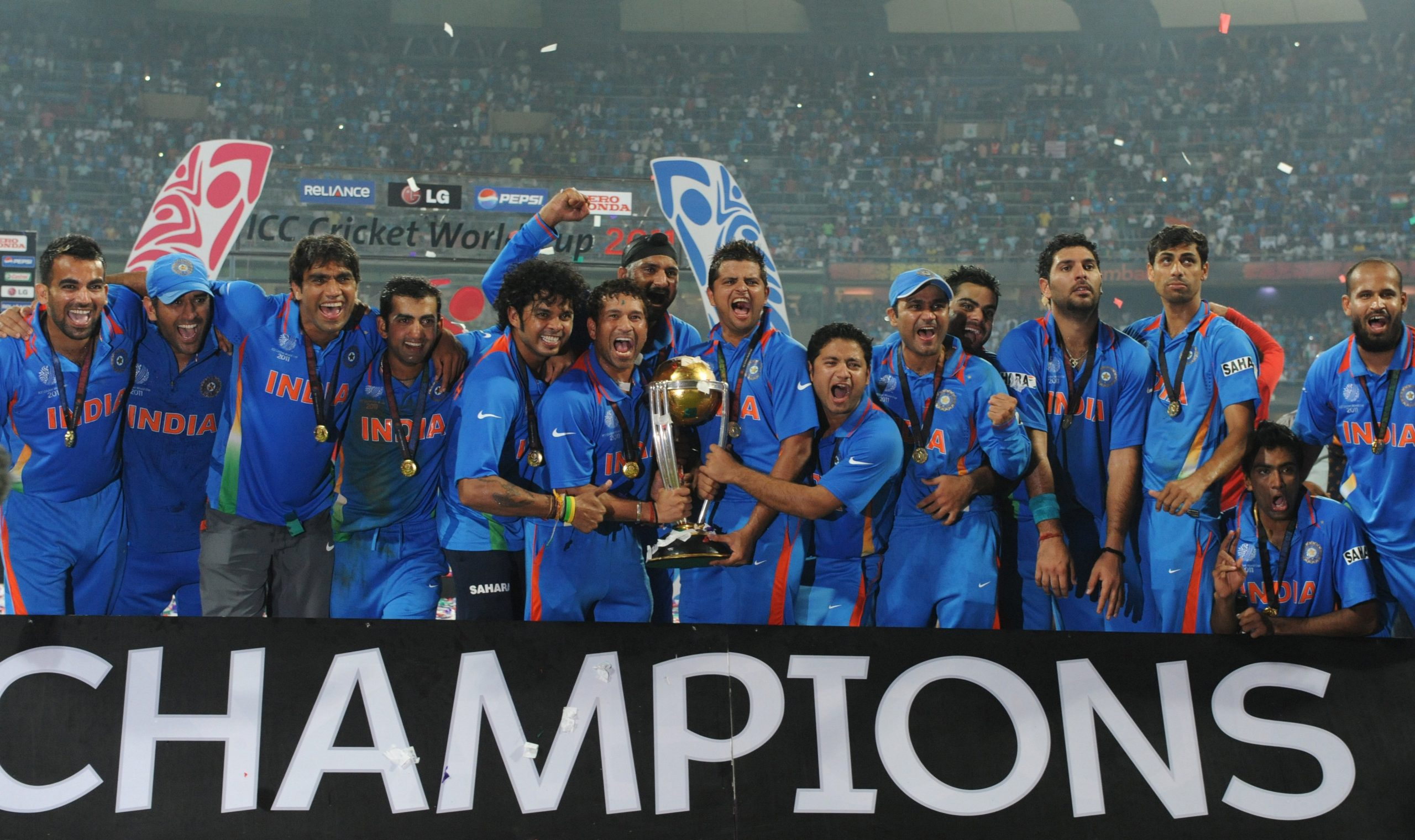 Indian cricketers pose with the trophy after victory in the Cricket World Cup 2011 final over Sri Lanka at The Wankhede Stadium in Mumbai on April 2, 2011. India beat Sri Lanka by six wickets.  AFP PHOTO/Indranil MUKHERJEE (Photo credit should read INDRANIL MUKHERJEE/AFP via Getty Images)