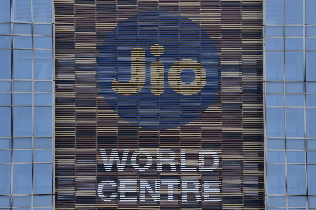 FILE PHOTO: The logo of Jio is seen at the facade of the Jio World Centre, in Navi Mumbai on April 22, 2020. (Photo by INDRANIL MUKHERJEE/AFP via Getty Images)