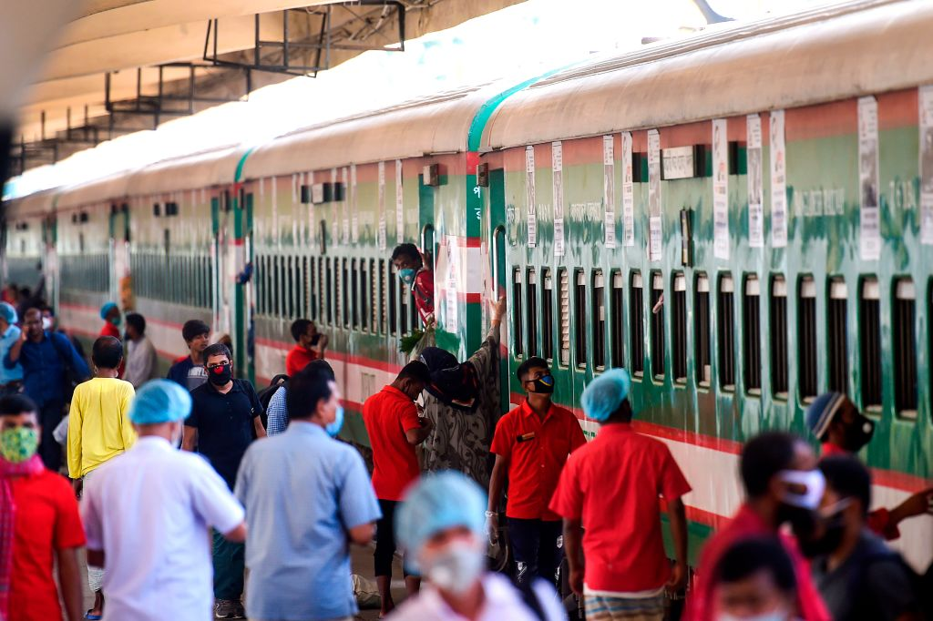 City dwellers arrive by a train after the government-imposed lockdown as a preventive measure against the COVID-19 coronavirus ended, in Dhaka on May 31, 2020. (Photo by MUNIR UZ ZAMAN/AFP via Getty Images)