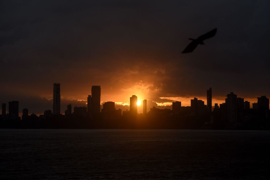 A general view shows clouds lingering over the city's skyline during the sunset in Mumbai on June 3, 2020, as cyclone Nisarga barrels towards India's western coast. (Photo by PUNIT PARANJPE/AFP via Getty Images)