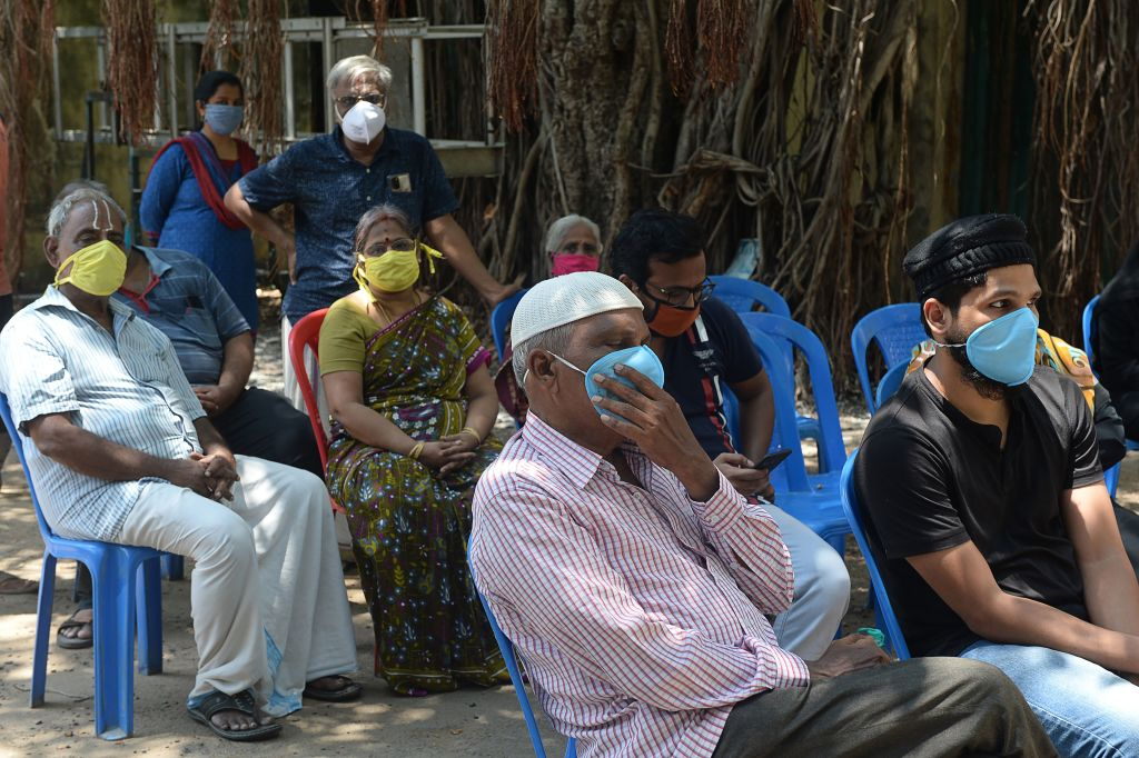 Residents wait to give their sample at a COVID-19 testing centre during a government-imposed nationwide lockdown as a preventive measure against the COVID-19 coronavirus in Chennai on June 26, 2020. (Photo by ARUN SANKAR/AFP via Getty Images)