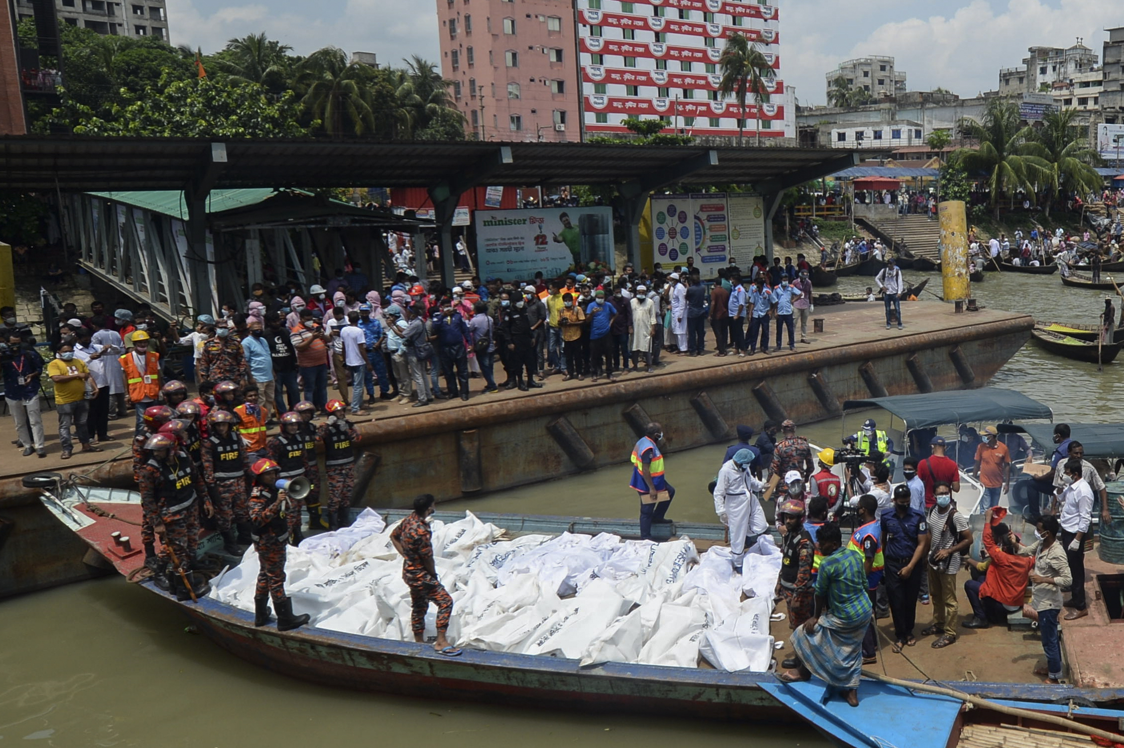 Rescue workers bring bodies of victims after a ferry capsized at the Sadarghat ferry terminal in Dhaka on June 29, 2020.  (Photo by Munir UZ ZAMAN / AFP) (Photo by MUNIR UZ ZAMAN/AFP via Getty Images)