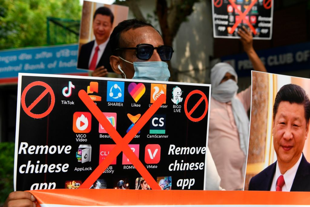Members of the Working Journalist of India (WJI) hold placards urging citizens to remove Chinese apps and stop using Chinese products during a demonstration against the Chinese newspaper Global Times, in New Delhi on June 30, 2020.  (Photo by PRAKASH SINGH/AFP via Getty Images)