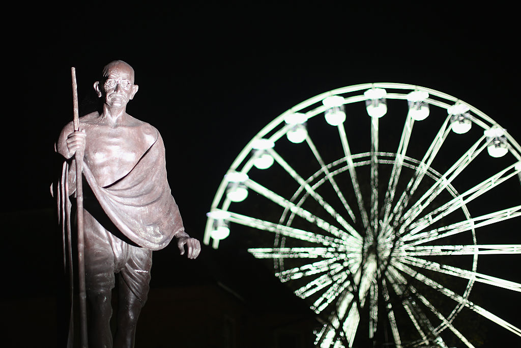FILE PHOTO: Statue of Mahatma Gandhi, with the Wheel of Light in the backdrop, in Leicester. (Christopher Furlong/Getty Images)