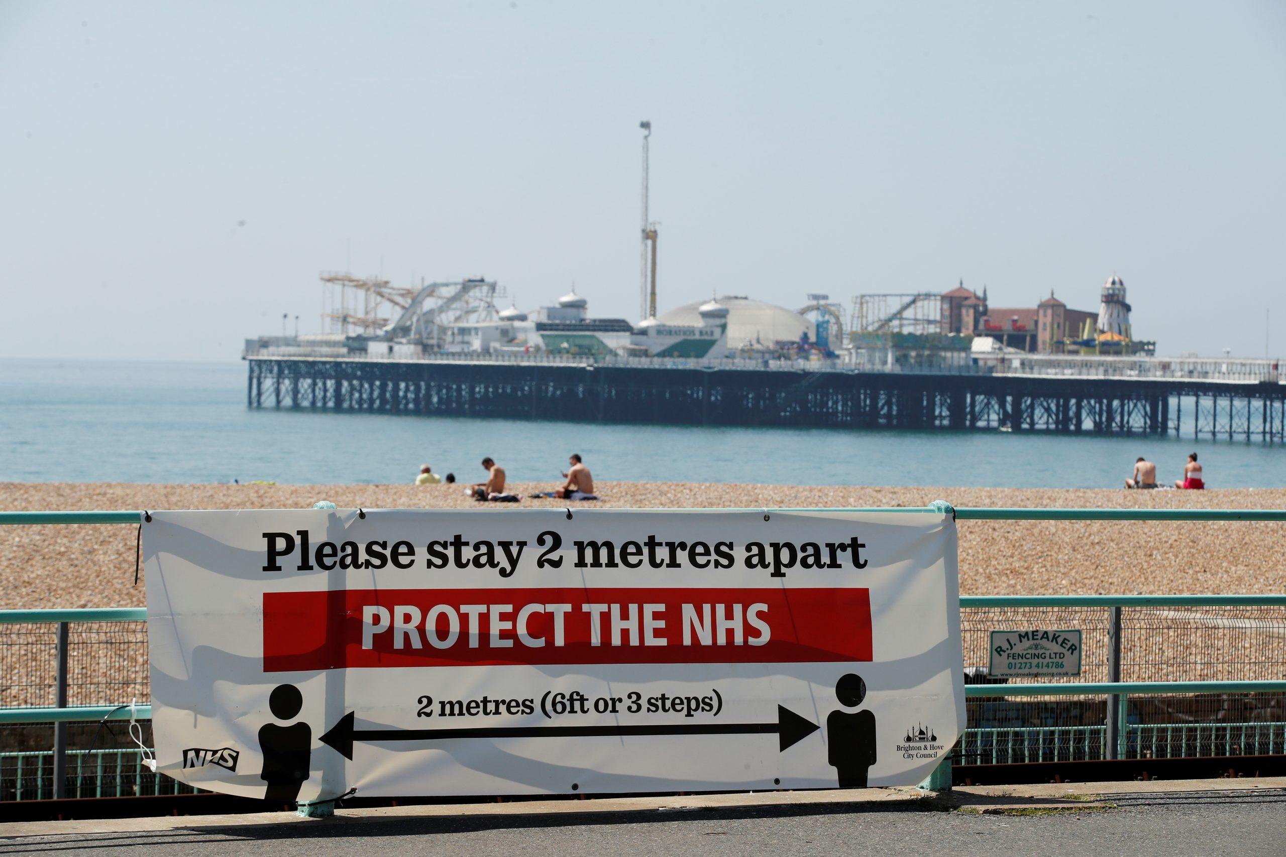 A social distancing banner at Brighton beach