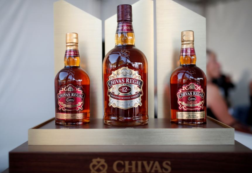 FILE PHOTO: Bottles of Chivas Regal blended Scotch whisky, produced by Pernod Ricard SA. REUTERS/Benoit Tessier/File Photo
