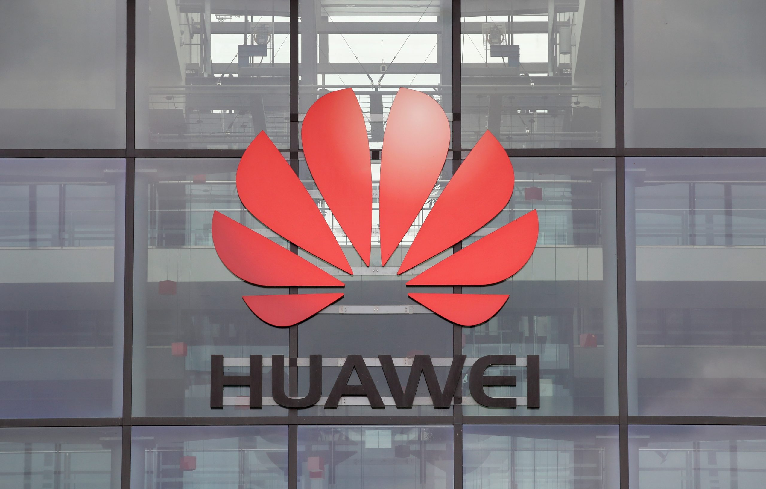 Huawei logo is pictured on the headquarters building in Reading on July 14, 2020. (REUTERS/Matthew Childs)