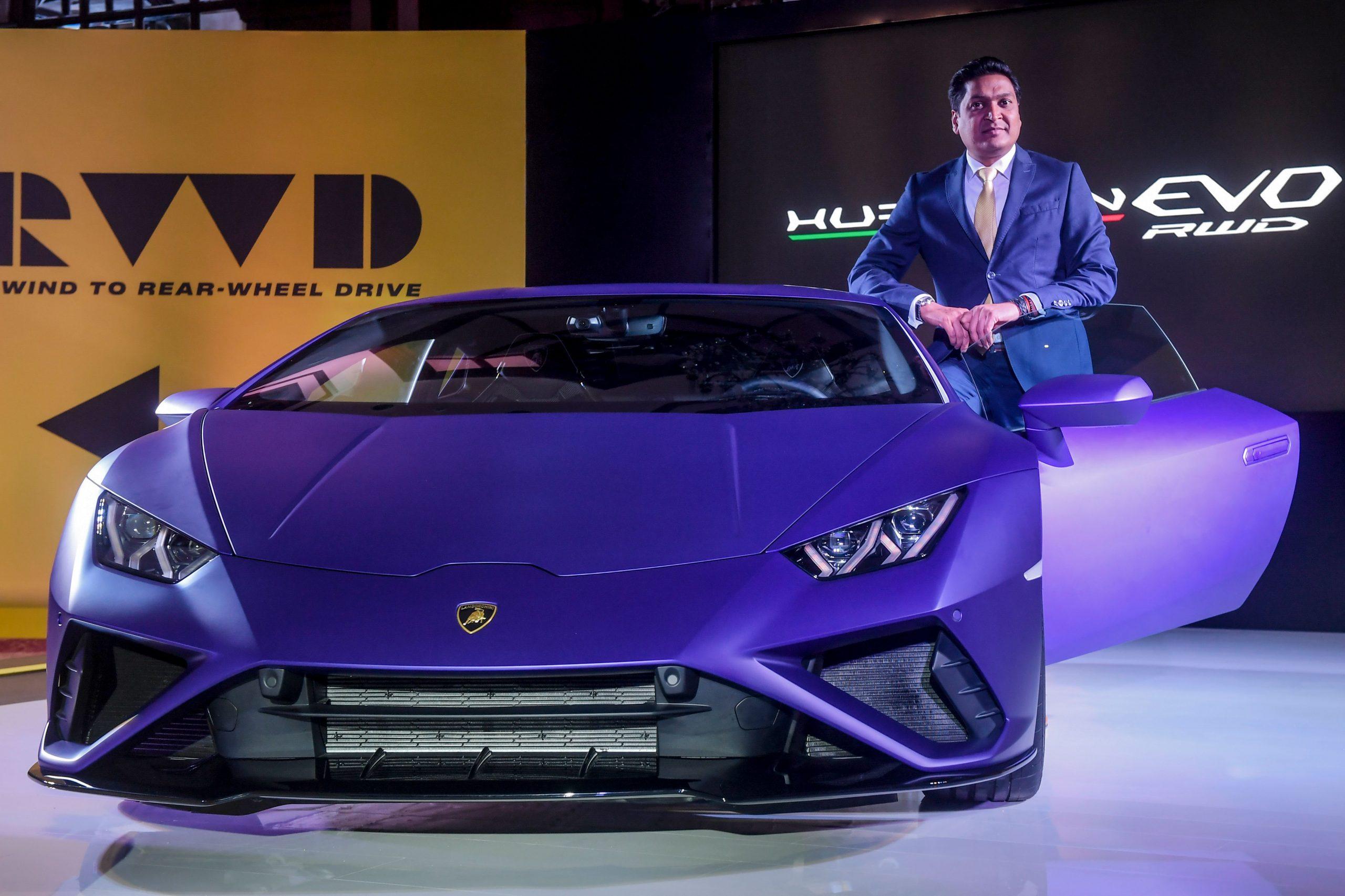 Head of Lamborghini India Sharad Agarwal poses next to the new Lamborghini Huracan EVO Rear-Wheel Drive (RWD) car during a show in Kolkata on February 2, 2020. (Photo by Dibyangshu SARKAR / AFP)
