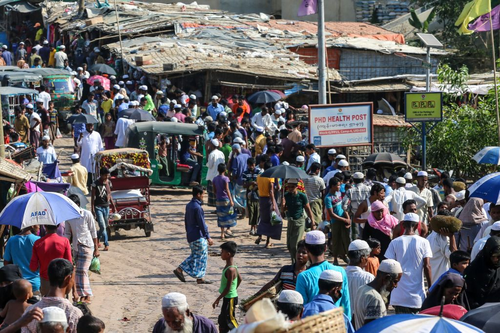 Rohingya refugees gather at a market as first cases of COVID-19 coronavirus have emerged in the area, in Kutupalong refugee camp in Ukhia on May 15, 2020. (Photo by SUZAUDDIN RUBEL/AFP via Getty Images)