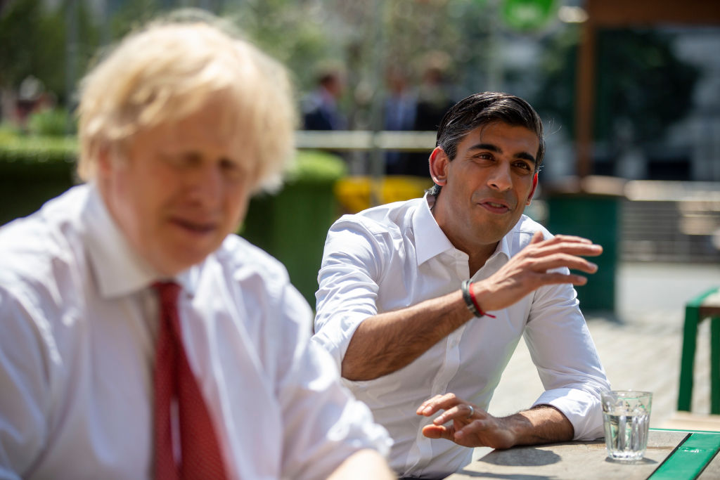 British Prime Minister Boris Johnson and Chancellor Rishi Sunak at an eatery  in West India Quay, London Docklands. (Photo: Heathcliff O'Malley/Getty Images)