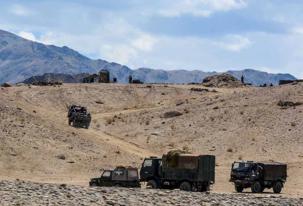 Indian army soldiers drive vehicles along mountainous roads as they take part in a military exercise at Thikse in Leh district of the union territory of Ladakh on July 4, 2020. (Photo by MOHD ARHAAN ARCHER/AFP via Getty Images)
