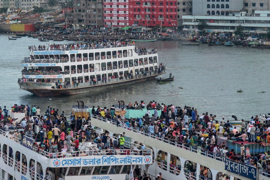 Crowds of people gather on ferries as they travel back home ahead of the Muslim festival Eid al-Adha or the 'Festival of Sacrifice' in Dhaka on July 30, 2020. (Photo by MUNIR UZ ZAMAN/AFP via Getty Images)