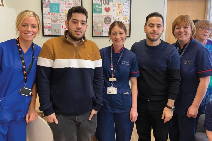 Hessam and Hamed with the NHS staff.
