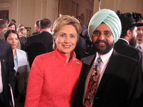 Dr Rajwant Singh (right), president of EcoSikh, and co-founder, National Sikh Campaign seen here with Hilary Clinton