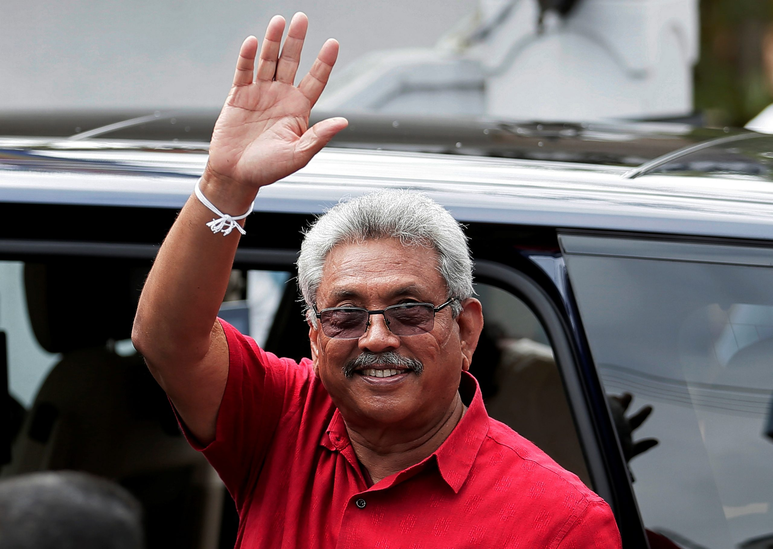 Sri Lanka's President Gotabaya Rajapaksa waves at his supporters as he leaves a polling station after casting his vote during the country's parliamentary election in Colombo, Sri Lanka, August 5, 2020. REUTERS/Dinuka Liyanawatte