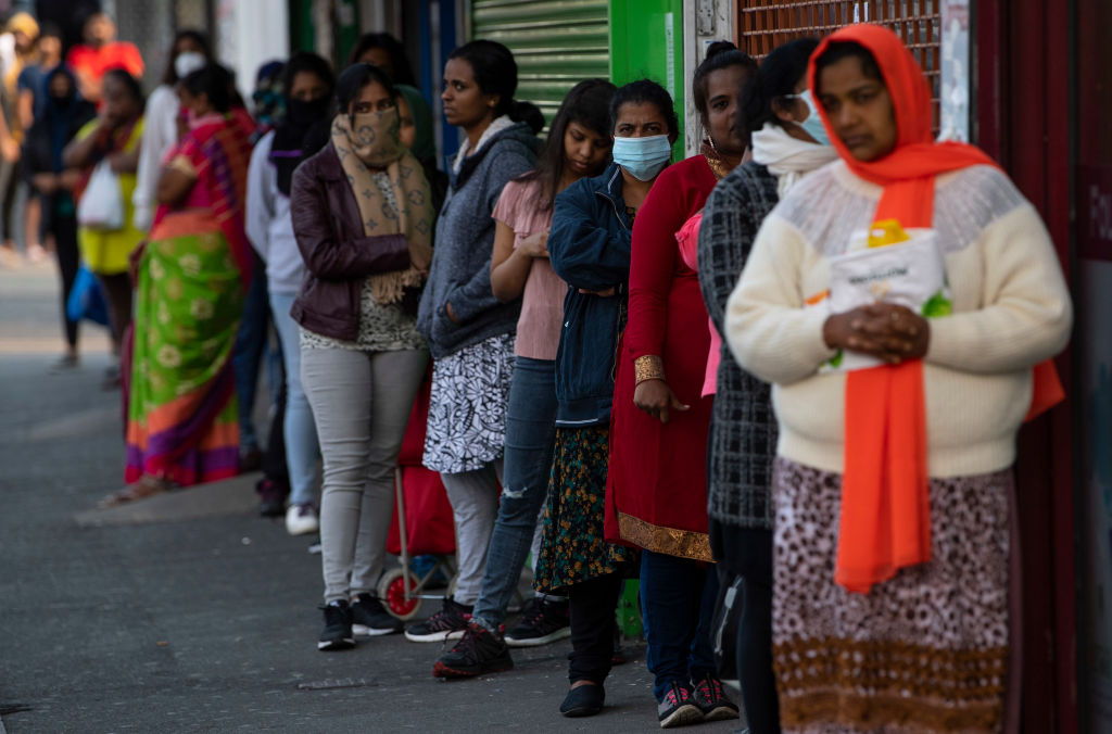 FILE PHOTO: Indian students and members of the Indian community queue for free food parcels at a local restaurant prepared by the Malayalee Association of the United Kingdom in the London borough of Newham on May 08, 2020 in London, England.  (Photo by Justin Setterfield/Getty Images)