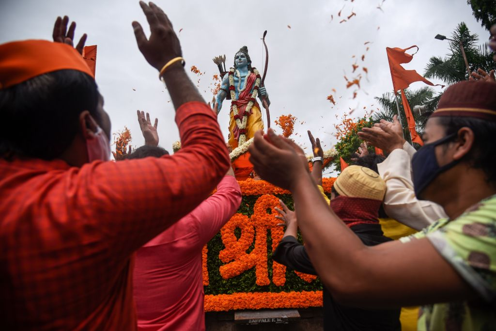 People from the Hindu and Muslim communities celebrate around a 7-feet tall statue of Lord Ram the foundation stone of a Lord Ram temple in Ayodhya, in Pune on August 5, 2020.  (Photo: SANKET WANKHADE/AFP via Getty Images)