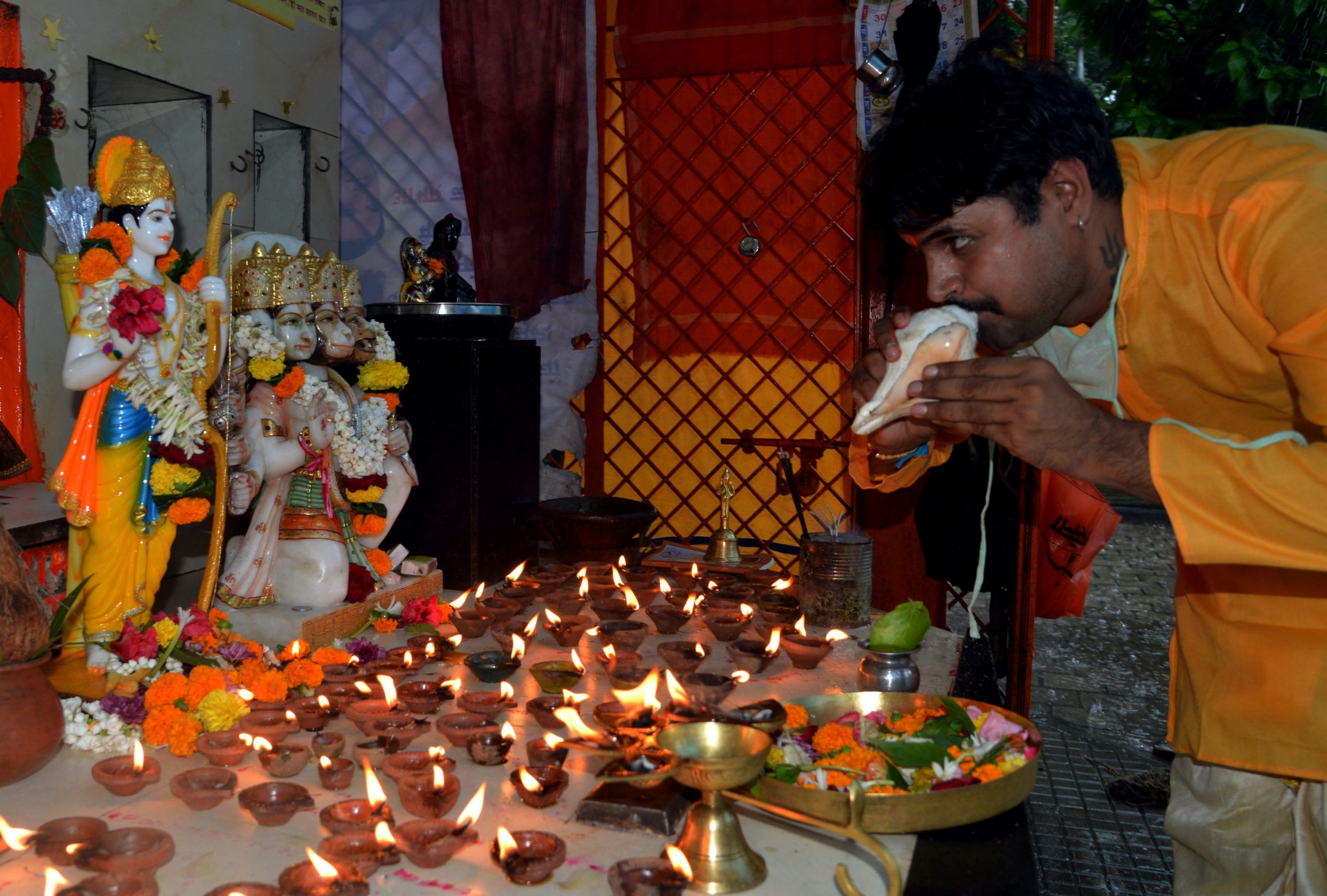 A Hindu devotee performs a ritual while offering orayers to Hindu deity Ram for the groundbreaking ceremony of the Ram Temple in Ayodhaya, in Mumbai on August 5, 2020. - Indian Prime Minister Narendra Modi took centre stage on August 5 at a ceremony laying the foundations for a temple at a flashpoint holy site exactly a year after imposing direct rule on Muslim-majority Kashmir -- twin triumphs for his Hindu nationalist government. (Photo by Sujit Jaiswal / AFP) (Photo by SUJIT JAISWAL/AFP via Getty Images)