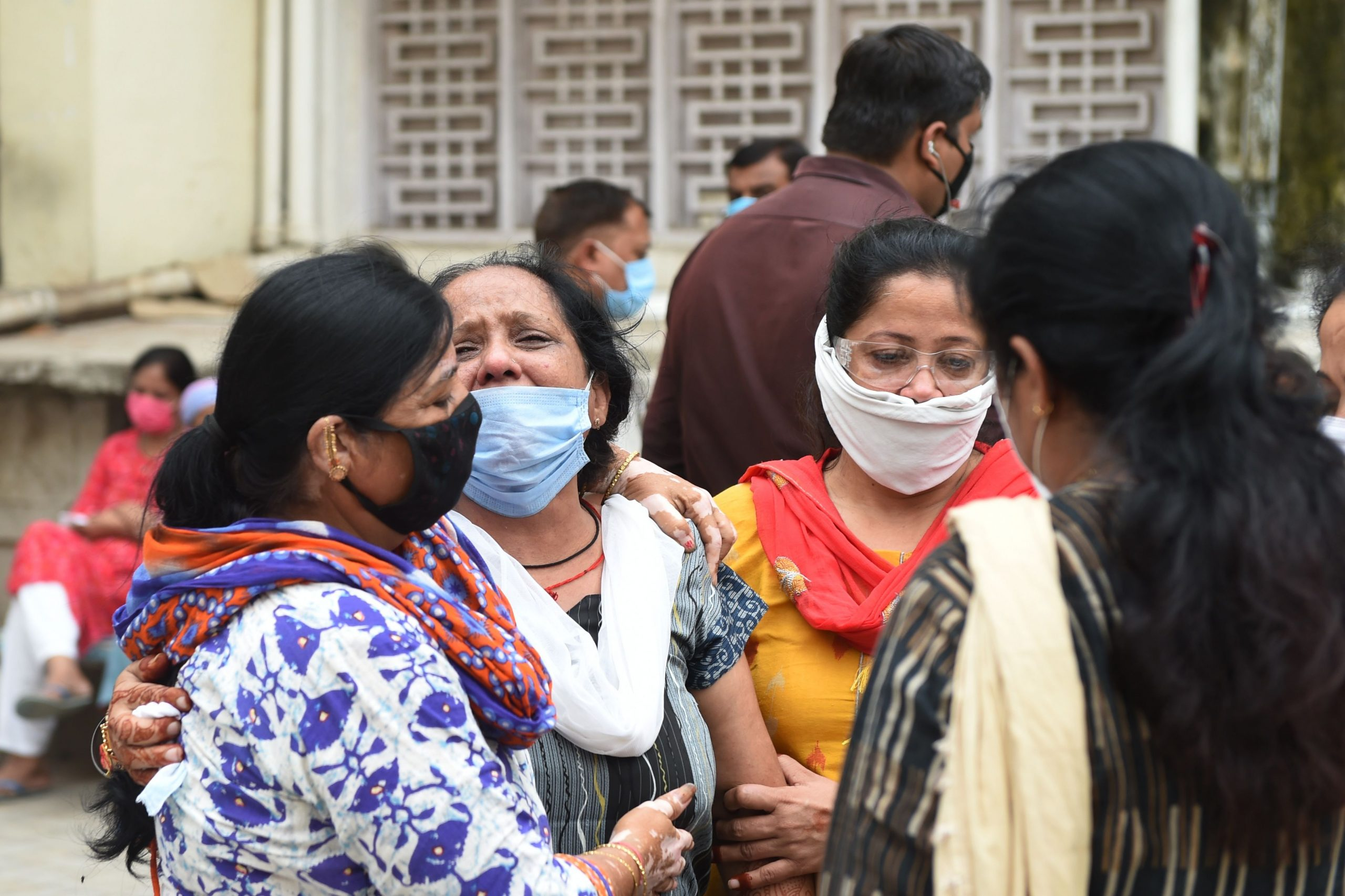 Relatives grief for their loved one outside the mortuary room of the Civil Hospital in Ahmedabad on August 6, 2020, after a fire broke early in the morning in the intensive care unit of the Shrey Hospital killing 8 coronavirus patients. - (Photo by SAM PANTHAKY/AFP via Getty Images)