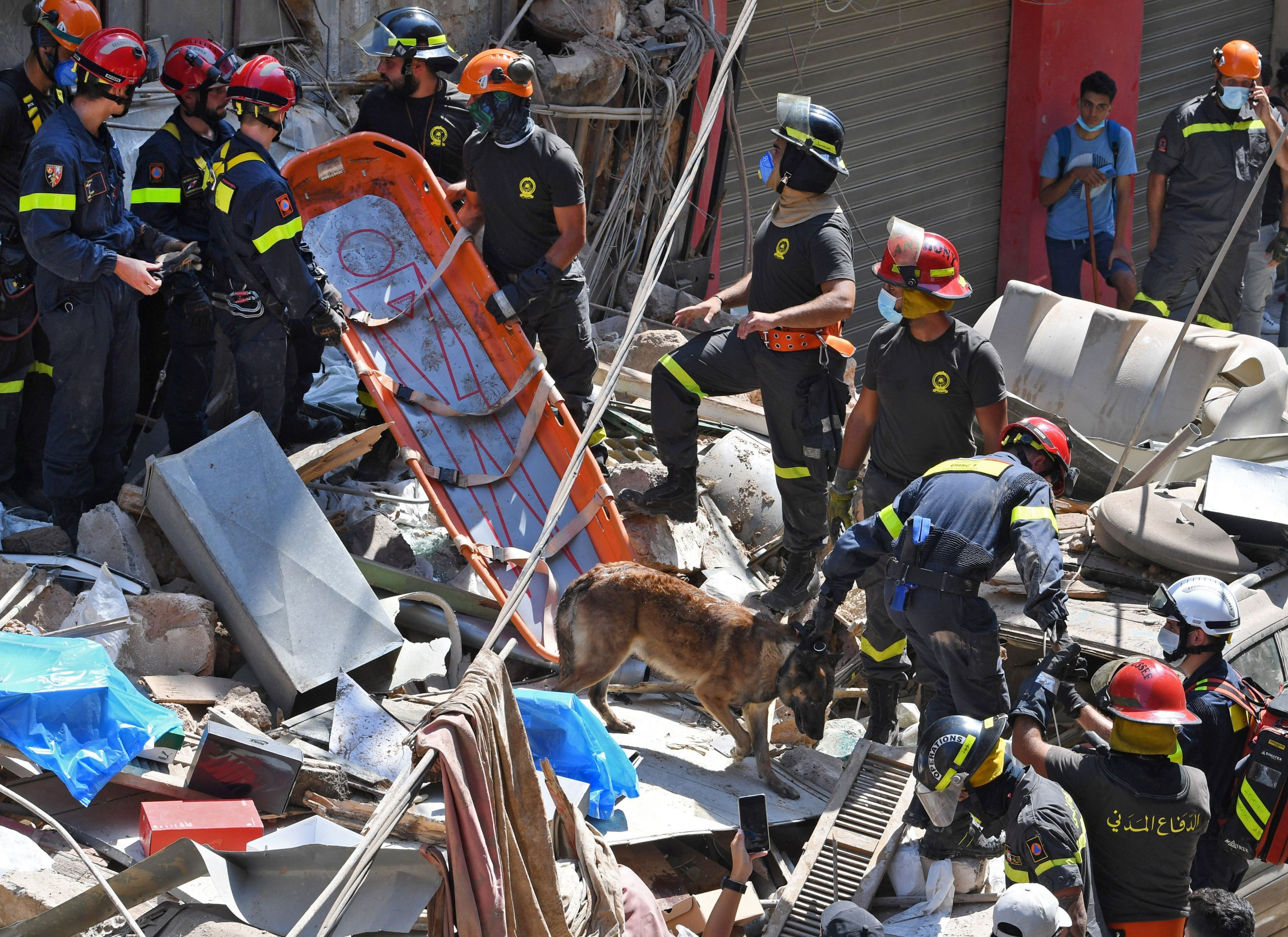 Lebanese and French rescuers search for victims or survivors amidst the rubble of a building in the Gemayzeh neighbourhood on August 6, 2020, two days after a massive explosion in the Beirut port shook the capital. (Photo by -/AFP via Getty Images)