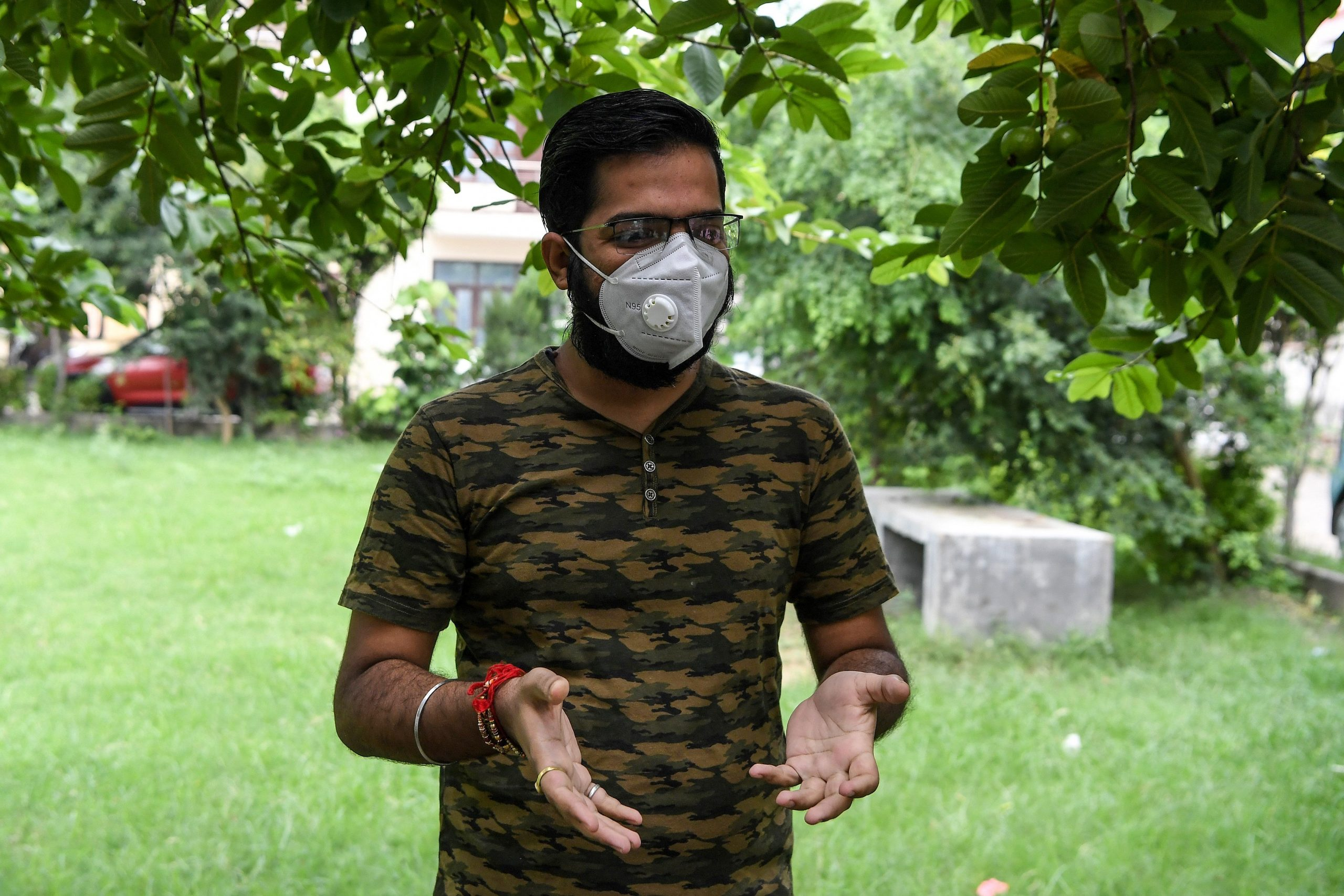 Sarthak Anand wearing a facemask gestures as he speaks during an interview with AFP at his home in Bahadurpur village of Meerut in Uttar Pradesh state. (Photo by PRAKASH SINGH/AFP via Getty Images)