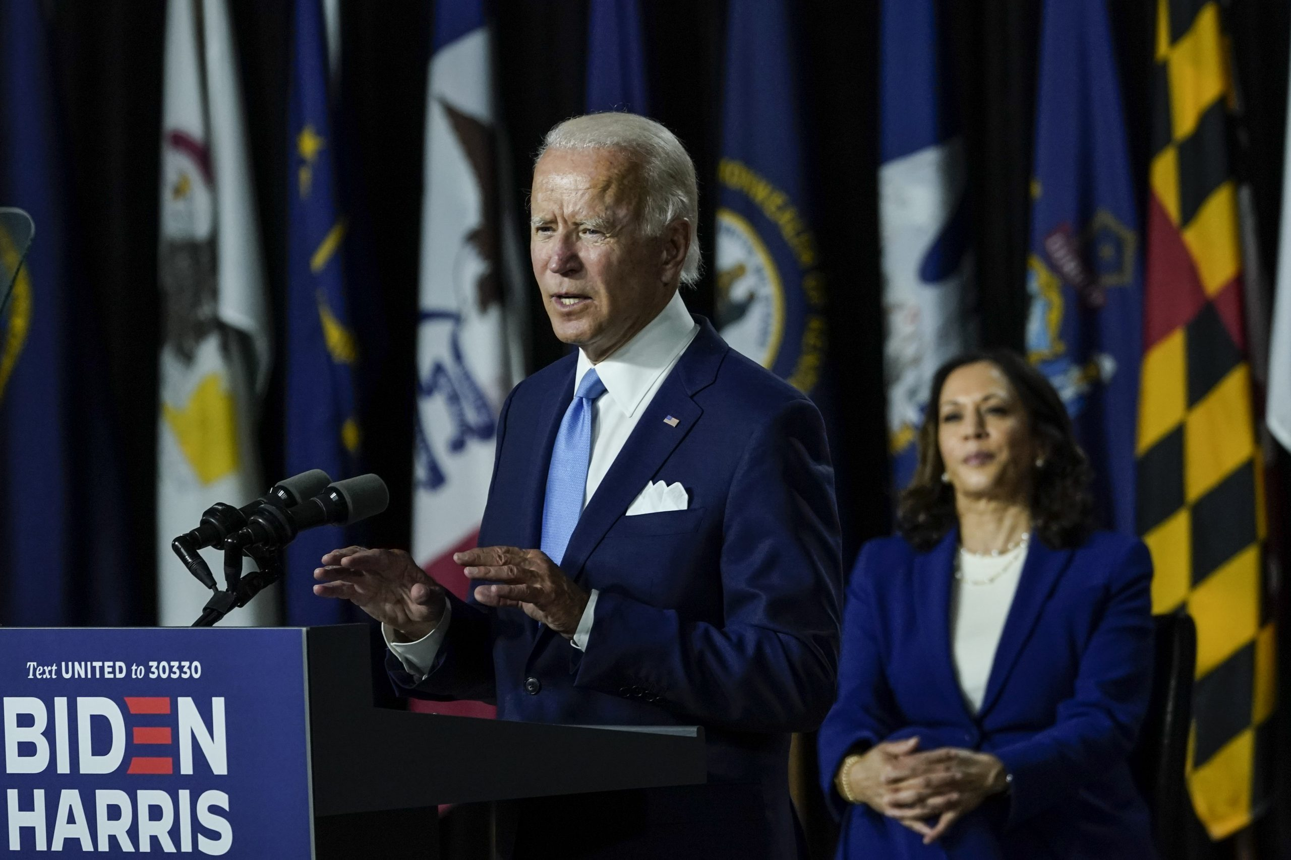 Joe Biden (L) speaks as his running mate Sen. Kamala Harris (D-CA) looks on.   (Photo by Drew Angerer/Getty Images)