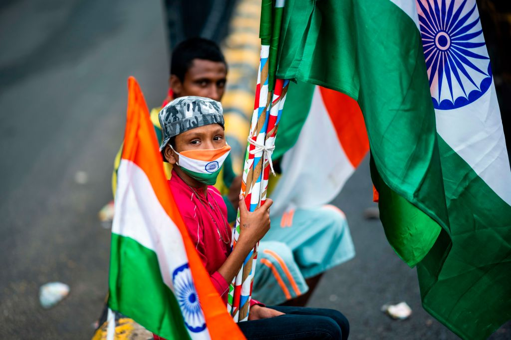 A boy wearing a Indian tricolour facemask as he sells national flags on a street ahead of the country's 74th Independence Day, in New Delhi on August 13, 2020.  (Photo: JEWEL SAMAD/AFP via Getty Images)