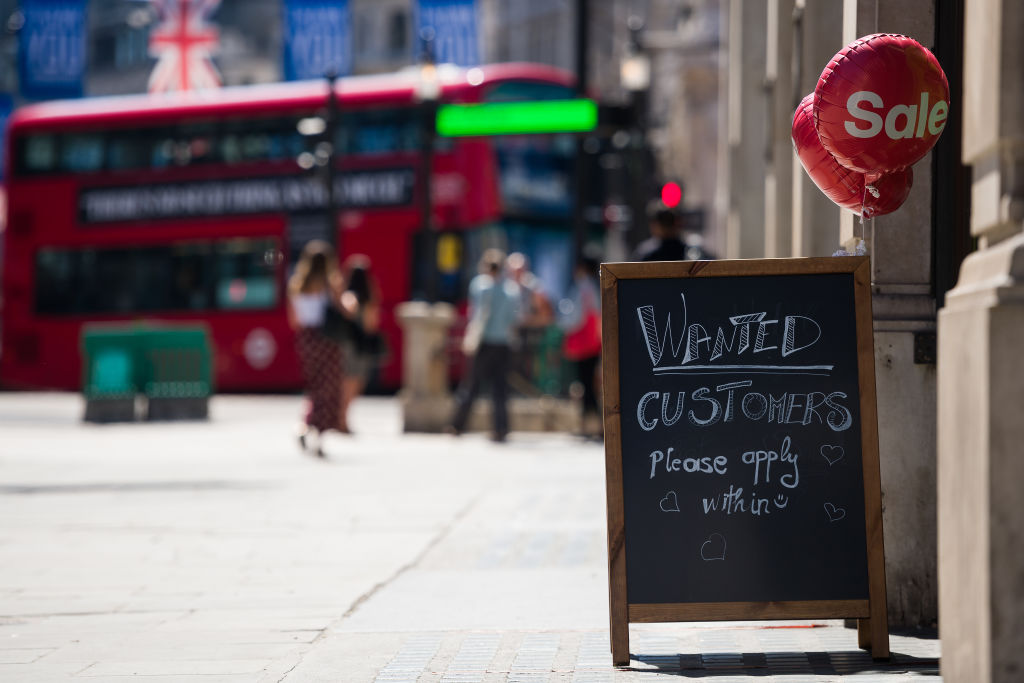 """A shop sign requests customers to """"apply within"""" on August 05, 2020 in London. Many UK businesses are announcing job losses due to the pandemic. (Photo: Leon Neal/Getty Images)"""