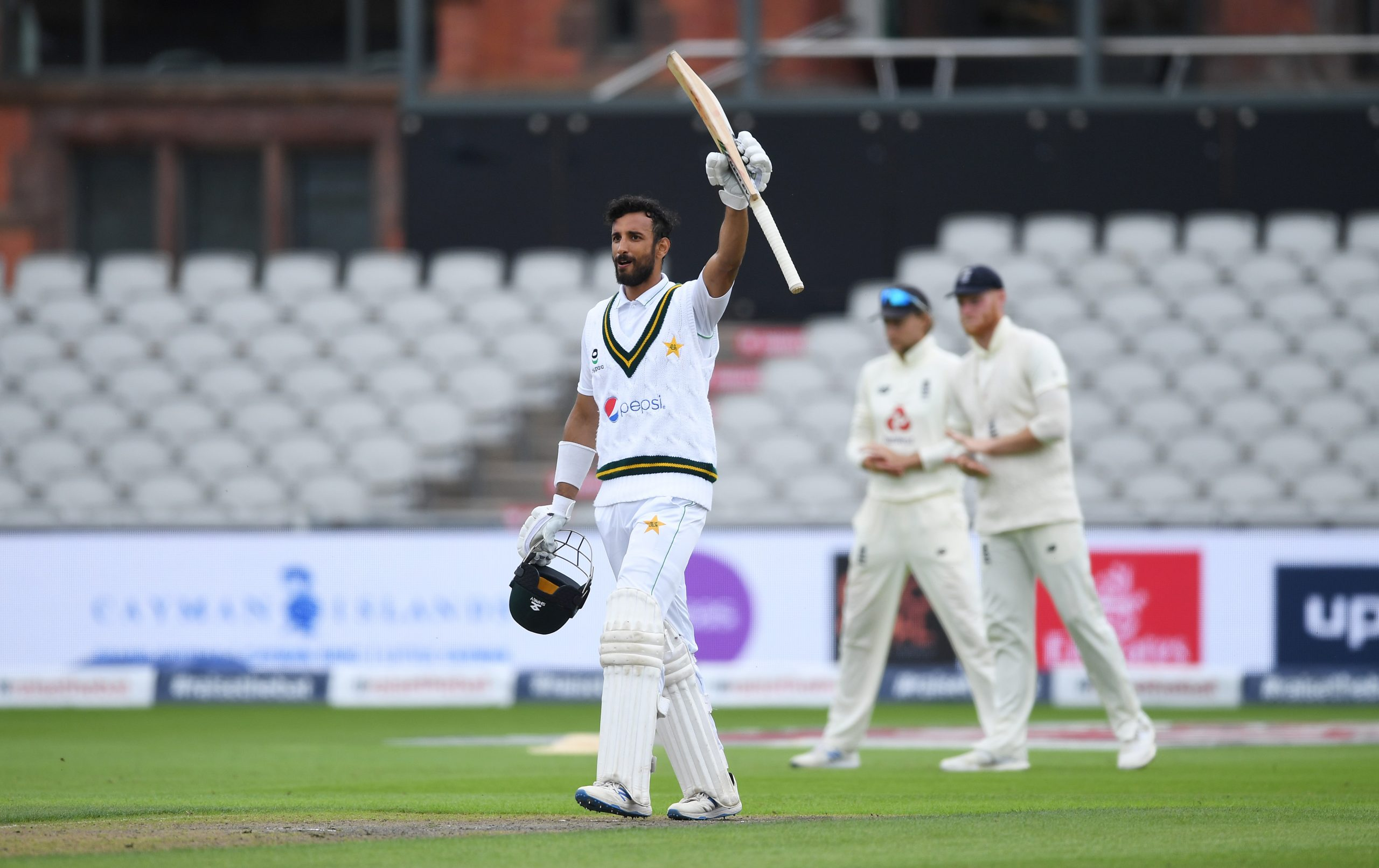 Masood of Pakistan celebrates reaching his century during Day Two of the 1st #RaiseTheBat Test Match between England and Pakistan at Emirates Old Trafford on August 06, 2020 in Manchester, England. (Photo: Gareth Copley/Getty Images for ECB).