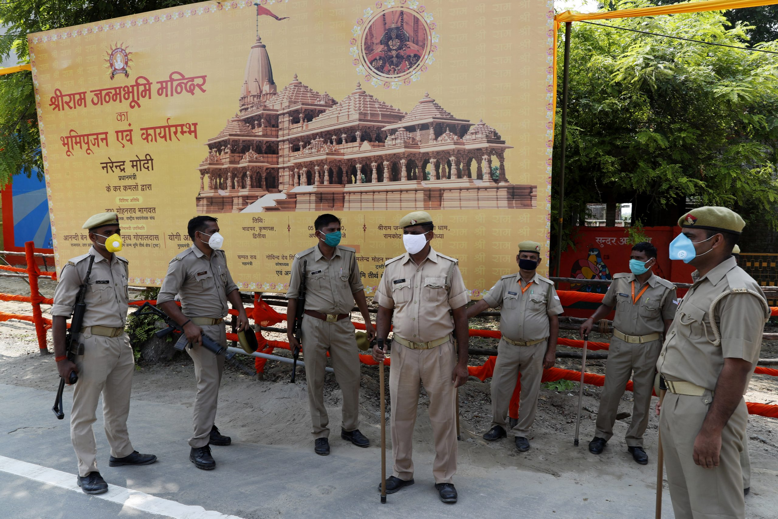Policemen stand guard ahead of a groundbreaking ceremony of a temple dedicated to the Hindu god Ram in Ayodhya, in the Indian state of Uttar Pradesh, Tuesday, Aug. 4, 2020. (AP Photo/Rajesh Kumar Singh)