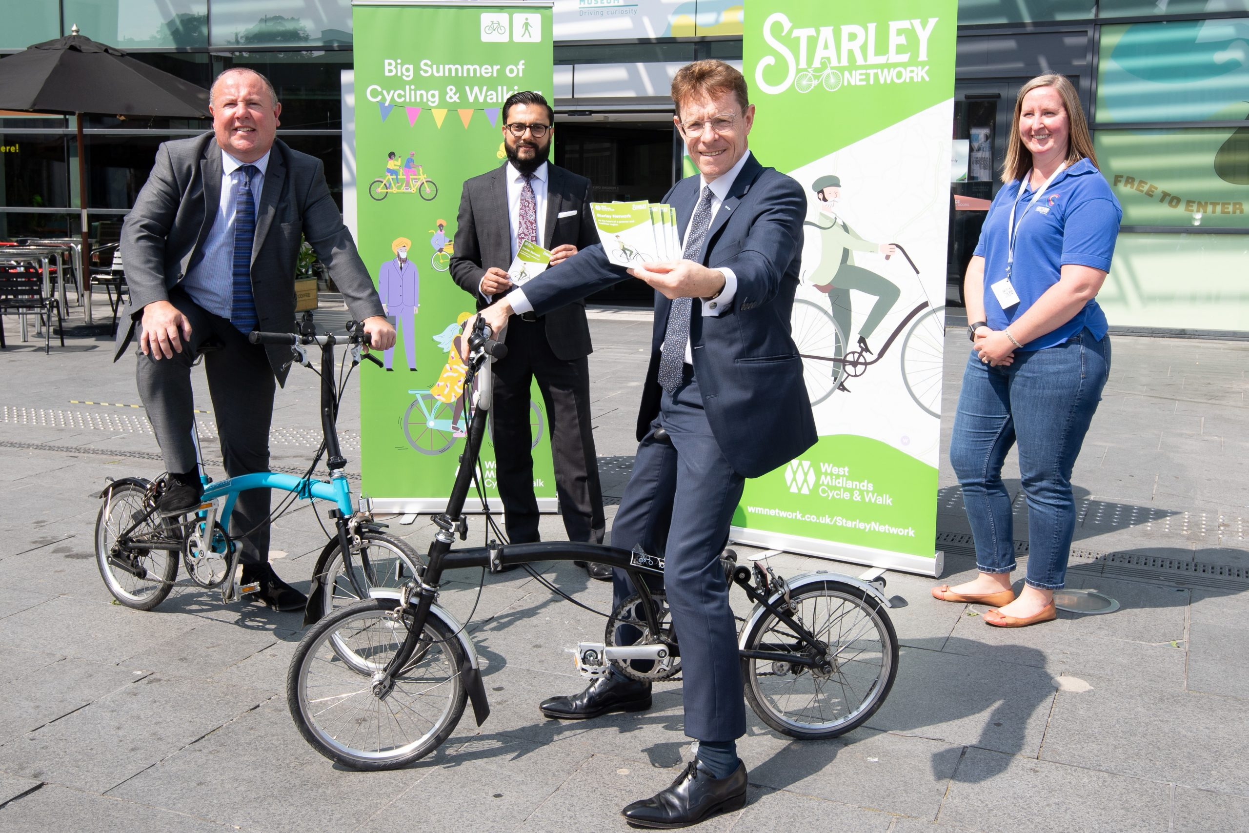 (From left) Councillor Jim O'Boyle, Coventry City Council cabinet member for jobs and regeneration, Sandeep Shingadia, TfWM's director of development and delivery, Mayor of the West Midlands Andy Street, and Megan Nass, curator of cycles and transport objects at Coventry Transport Museum.
