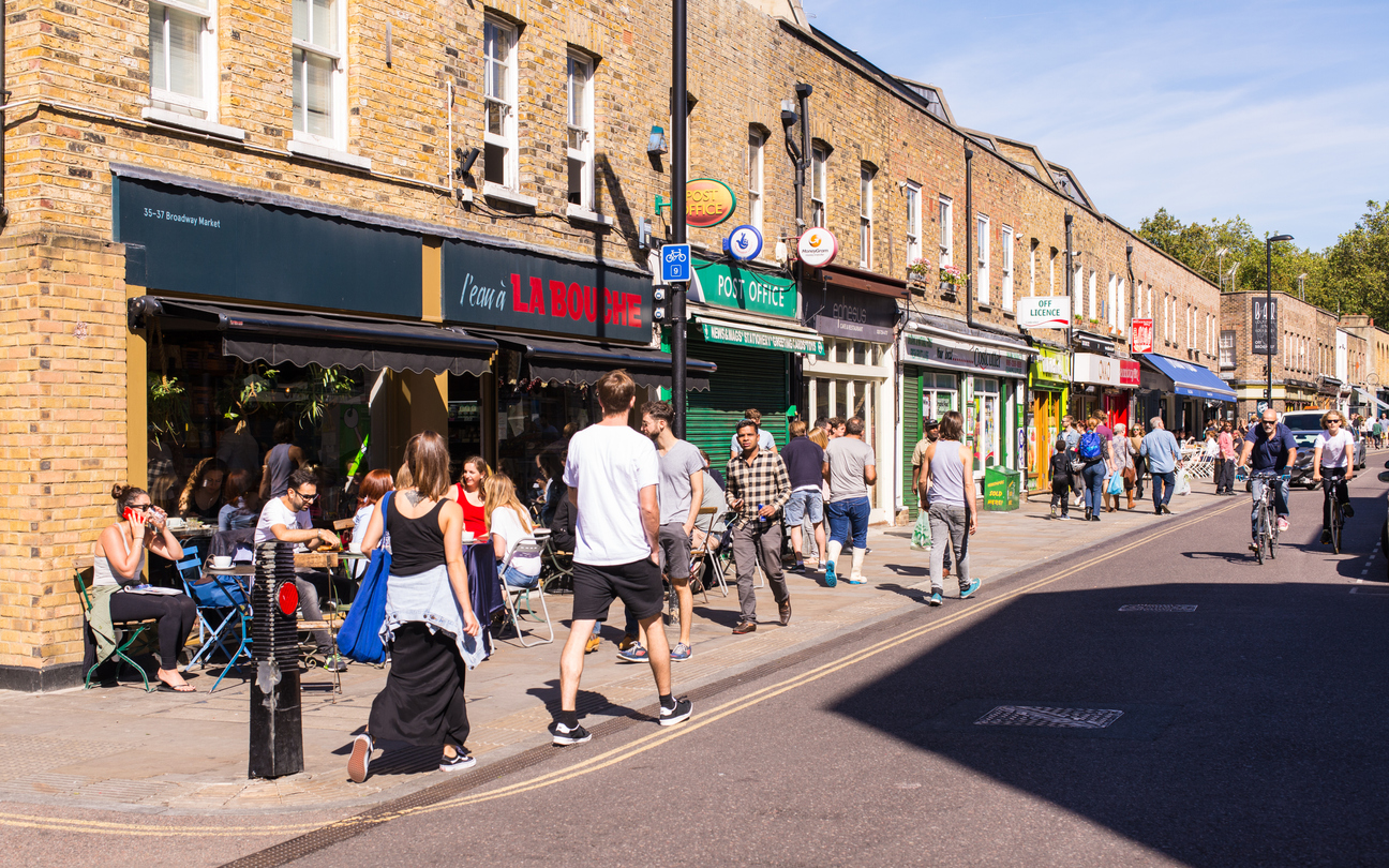 FILE PHOTO: People walking in front of local shops and restaurants in Broadway Market, East London (iStock)
