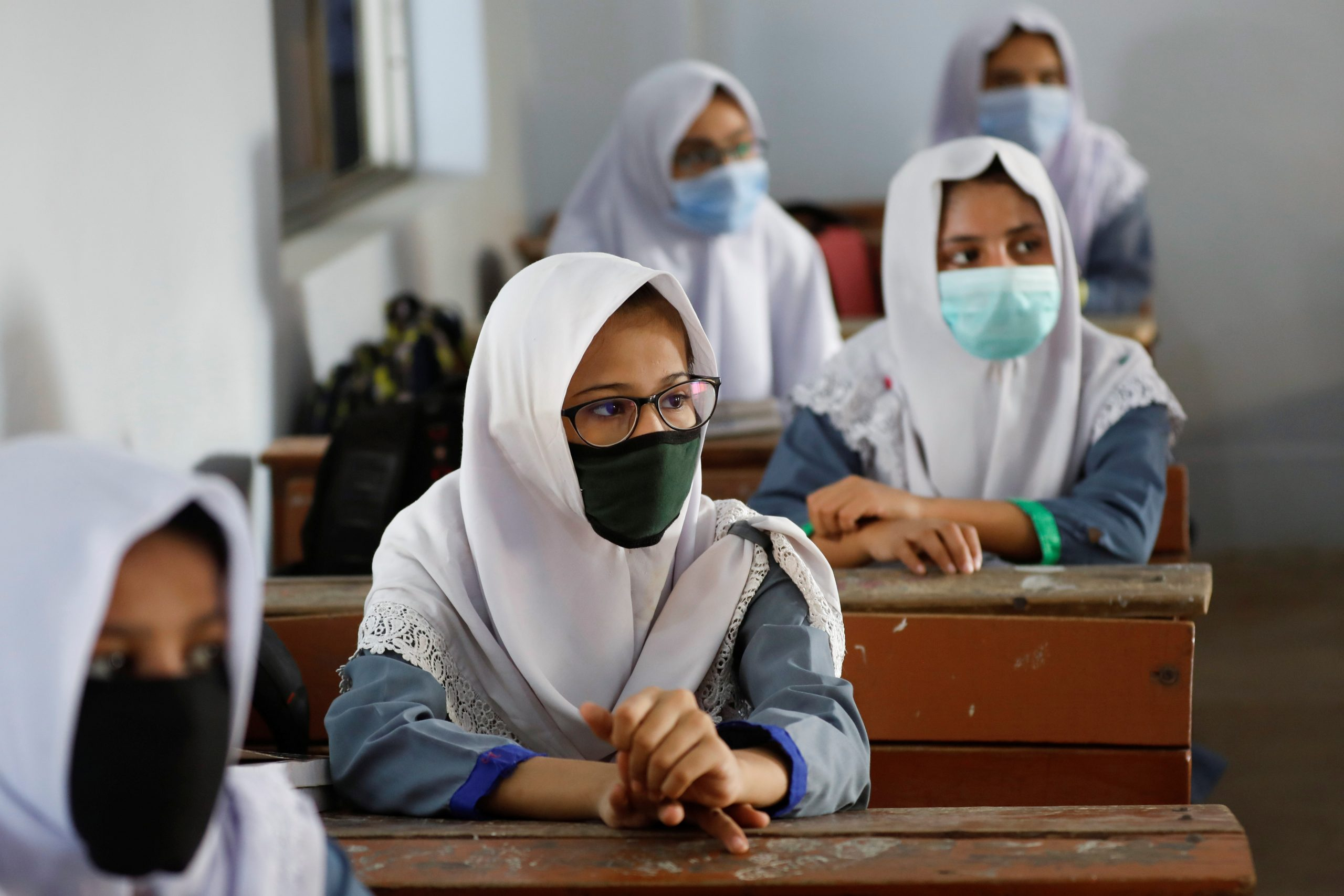 Students keep safe distance while attending a class as schools reopen amid the coronavirus disease (COVID-19) pandemic, in Karachi, Pakistan September 15, 2020. REUTERS/Akhtar Soomro