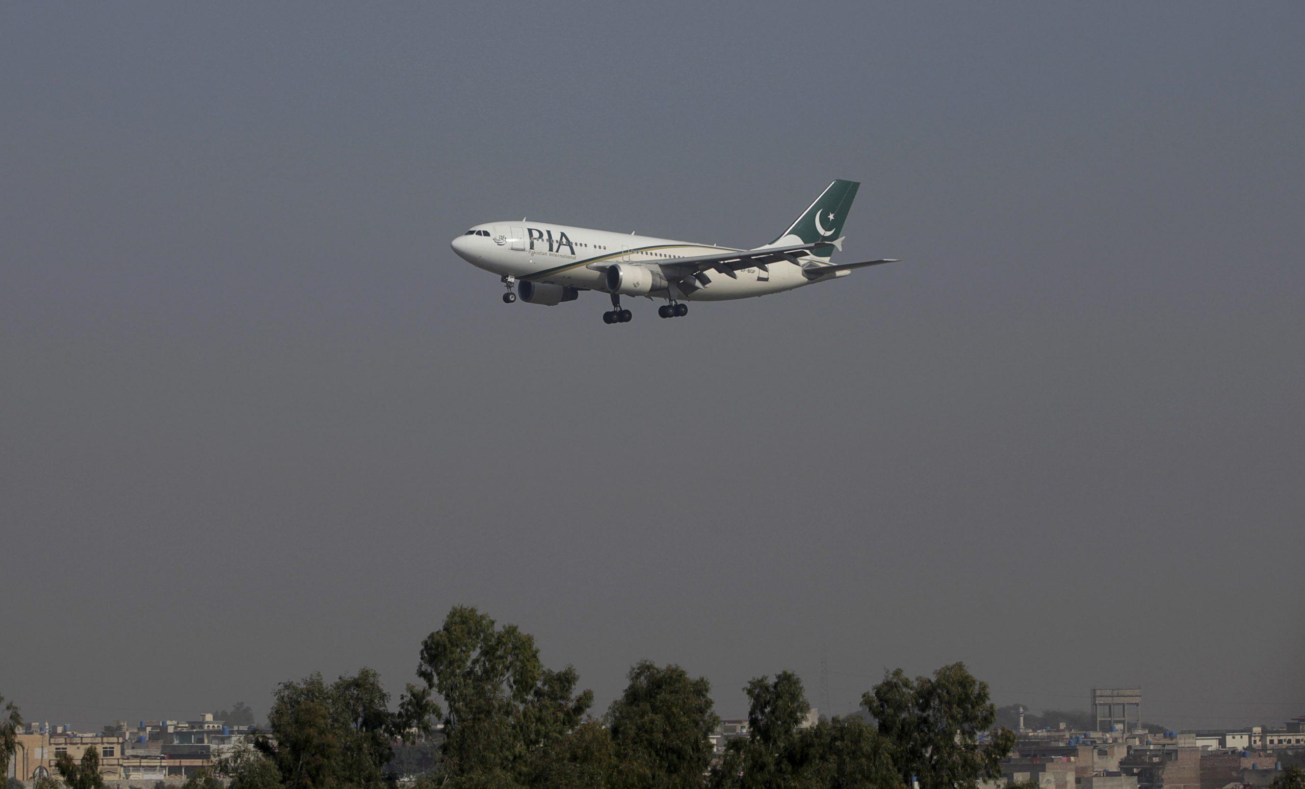 FILE PHOTO: A Pakistan International Airlines (PIA) passenger plane arrives at the Benazir International airport in Islamabad, Pakistan, December 2, 2015. REUTERS/Faisal Mahmood/File Photo