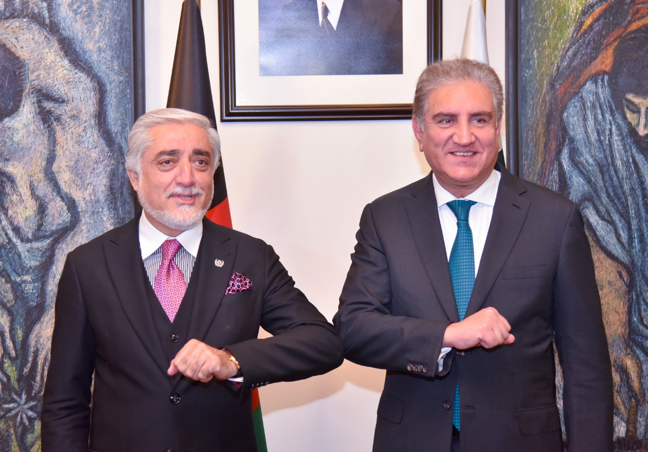 Pakistan's Foreign Minister Shah Mahmood Qureshi bumps elbows with the head of the Afghanistan's peace council, Abdullah Abdullah, upon his arrival at the Ministry of Foreign Affairs (MOFA) office in Islamabad, Pakistan September 28, 2020. Ministry of Foreign Affairs (MoFA) Handout via REUTERS