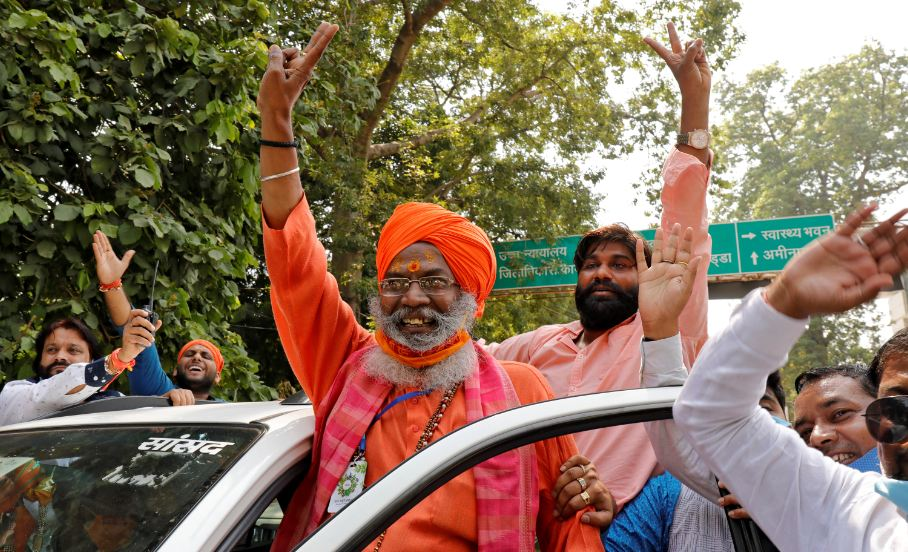 Sakshi Maharaj (in turban), a lawmaker from India's ruling Bharatiya Janata Party (BJP), flashes a victory sign after he was acquitted in a case over the demolition of a mosque at a disputed site 28 years ago, outside a court in Lucknow, India, September 30, 2020. REUTERS/Pawan Kumar
