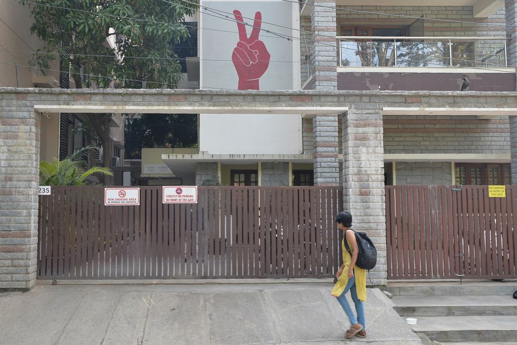FILE PHOTO: A pedestrian walks past the Amnesty International office in Bangalore on October 26, 2018. (MANJUNATH KIRAN/AFP via Getty Images)