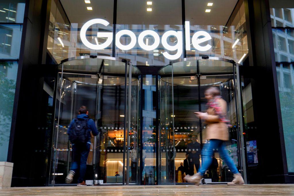 FILE PHOTO: People walk past Google's UK headquarters in London on November 1, 2018. (TOLGA AKMEN/AFP via Getty Images)