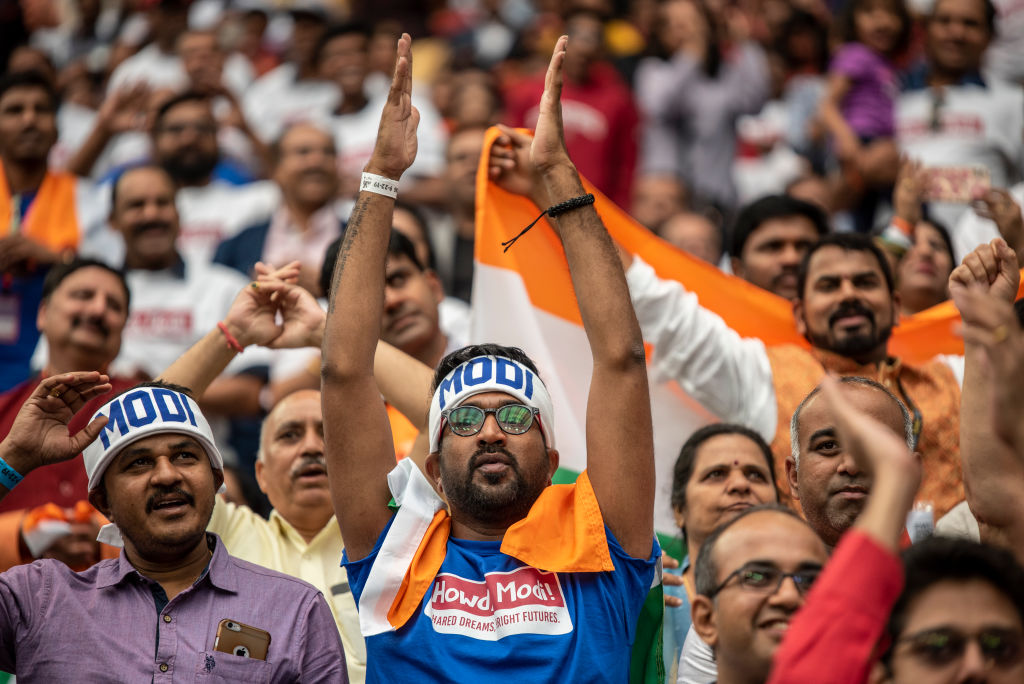 FILE PHOTO: Supporters cheer as Indian Prime Minster Narendra Modi speaks at NRG Stadium on September 22, 2019 in Houston, Texas.   (Sergio Flores/Getty Images)