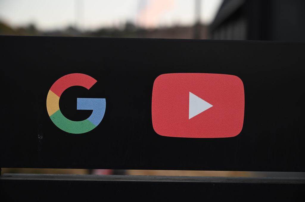 FILE PHOTO: The Google and YouTube logos are seen at the entrance to the Google offices in Los Angeles, California, November 21, 2019.(Photo by ROBYN BECK/AFP via Getty Images)