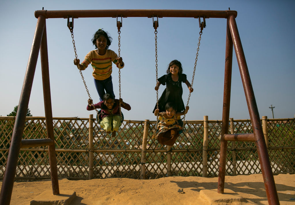 FILE PHOTO: Children play on a playground in a Rohingya refugee camp on January 23, 2020 in Cox's Bazar, Bangladesh. Children make up more than half of the roughly 700,000 Rohingya who arrived in Bangladesh in 2017. (Photo by Allison Joyce/Getty Images)