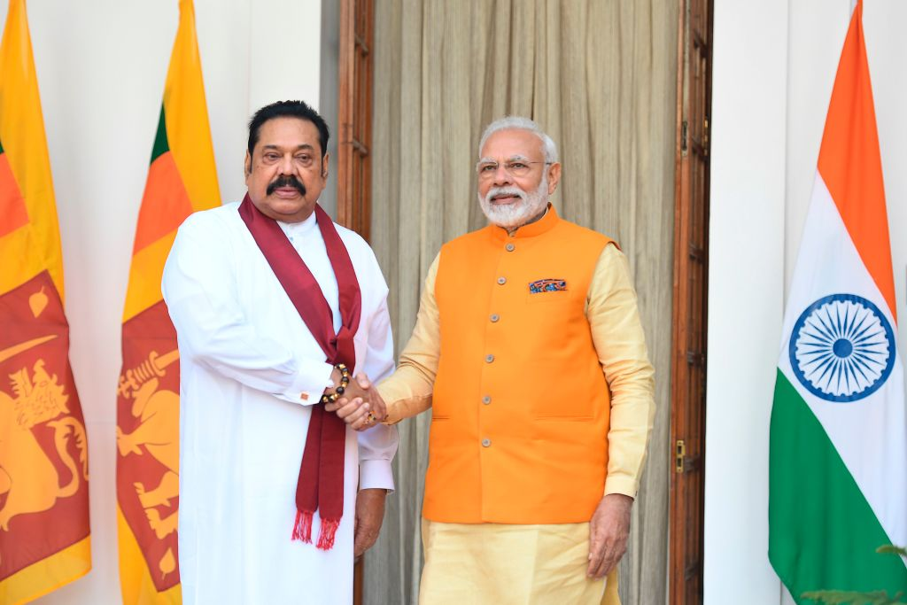 FILE PHOTO: India's prime minister Narendra Modi (R) shakes hands with Sri Lanka's Prime Minister Mahinda Rajapaksa prior to a meeting in New Delhi on February 8, 2020. (Photo by PRAKASH SINGH/AFP via Getty Images)