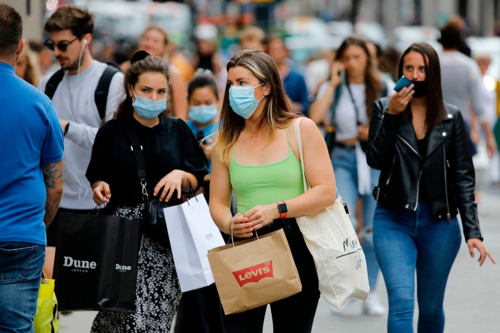 FILE PHOTO: Shoppers wear face masks on Oxford Street om London on July 24, 2020, after wearing facemasks in shops and supermarkets became compulsory in England as a measure to combat the spread of the novel coronavirus. (Photo by TOLGA AKMEN/AFP via Getty Images)