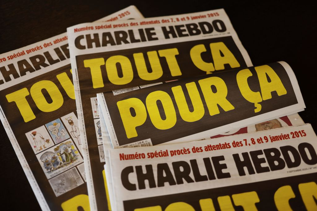 "FILE PHOTO: This picture taken on September 1, 2020 in Paris shows covers of French satirical weekly Charlie Hebdo reading ""All of this, just for that,"" to be published on September 2 to mark this week's start of the trial for 14 accused in January 2015 jihadist attacks in Paris. (Photo by -/AFP via Getty Images)"