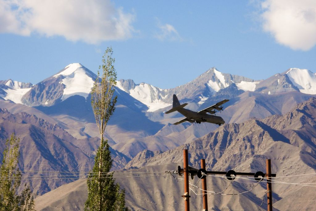 An Indian Air Force Hercules military transport plane prepares to land at an airbase in Leh, the joint capital of the union territory of Ladakh bordering China, on September 8, 2020.  (Photo by MOHD ARHAAN ARCHER/AFP via Getty Images)