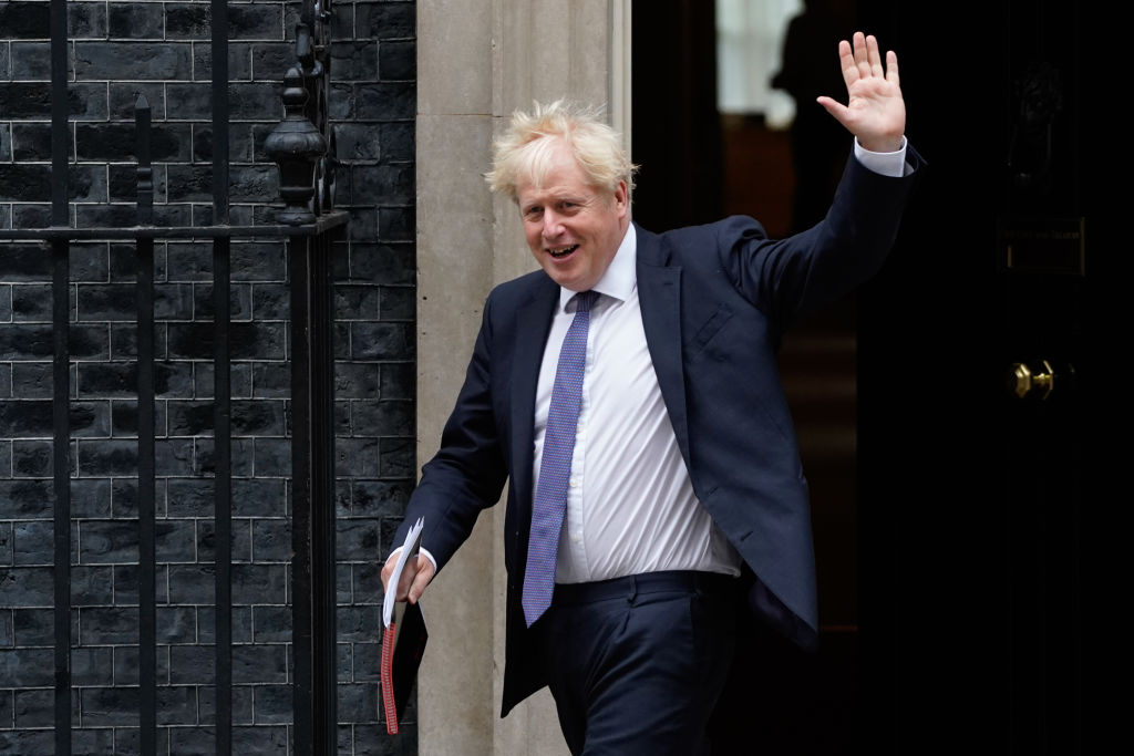 """Britain's prime minister Boris Johnson waves as he leaves 10 Downing Street in central London on September 8, 2020 to walk across to the Foreign, Commonwealth & Development Office (FCDO) to chair the weekly meeting of the cabinet. - Britain demanded """"more realism"""" from the European Union ahead of crucial post-Brexit trade talks on Tuesday, but the mood was soured by reports that London was looking to rewrite an agreement the two sides had already signed. (Photo by NIKLAS HALLE'N/AFP via Getty Images)"""