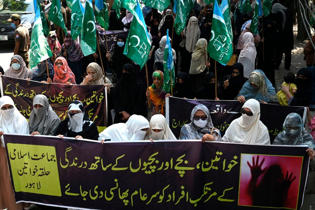 Women supporters of Pakistani Islamic political party Jamaat-e-Islami (JI) carry banners as they march during a protest against an alleged gang rape of a woman, in Lahore on September 11, 2020. (Photo by ARIF ALI/AFP via Getty Images)