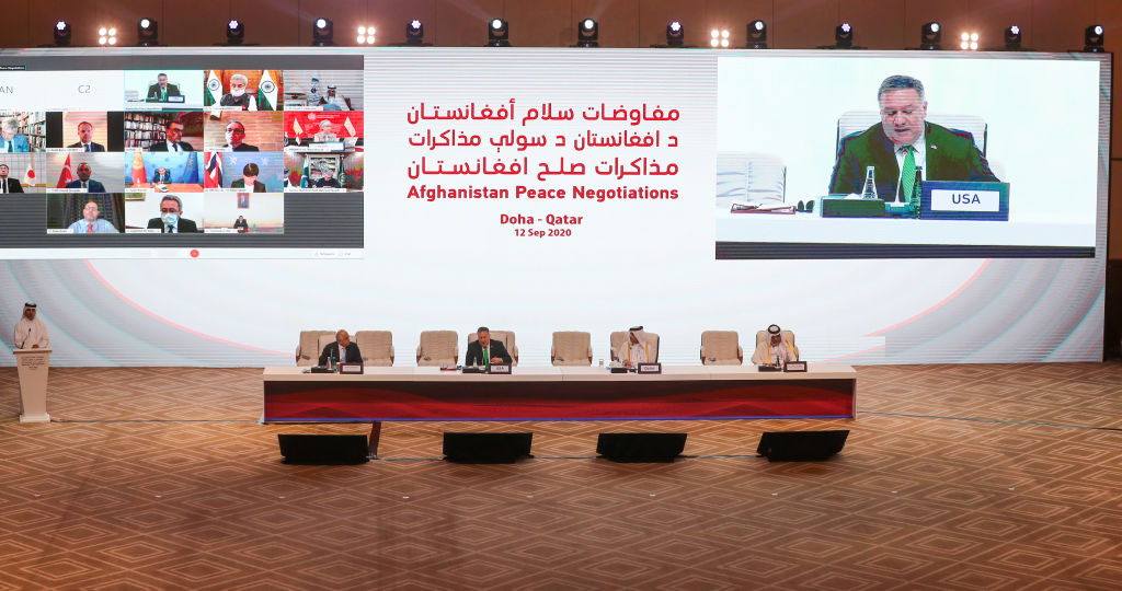 US secretary of state Mike Pompeo, is broadcasted on the screen, as he delivers a speech during the opening session of the peace talks between the Afghan government and the Taliban in the Qatari capital Doha on September 12, 2020. (Photo: KARIM JAAFAR/AFP via Getty Images)