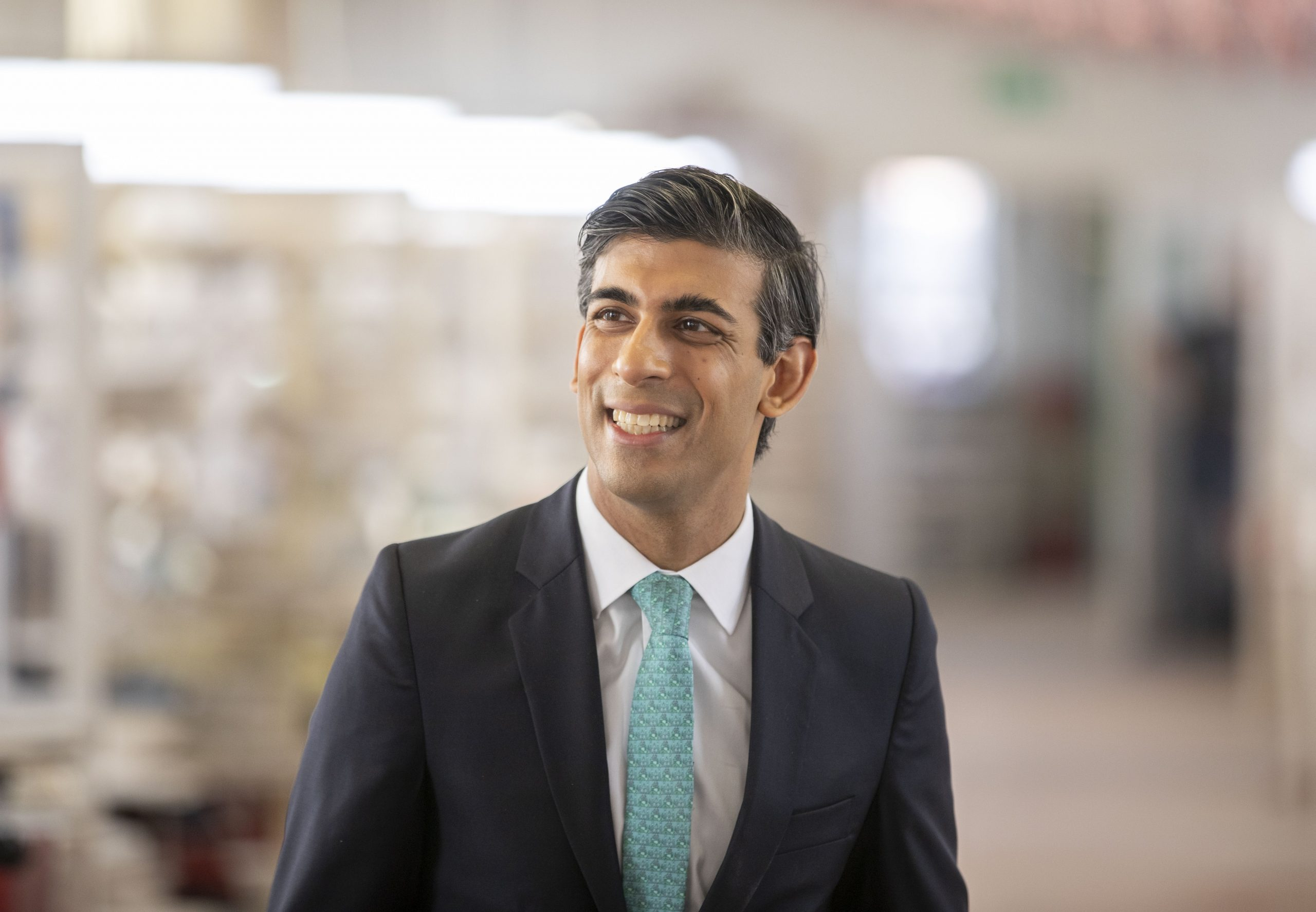 Britain's Chancellor of the Exchequer Rishi Sunak reacts during his  visit to the Emma Bridgewater pottery in Stoke-upon-Trent, central England, on September 14, 2020, where employees have returned to work after being furloughed due to the COVID-19 pandemic. - Britian's government has been paying up to 80 percent of wages for almost ten million workers under its furlough scheme. (Photo by Andrew Fox / POOL / AFP) (Photo by ANDREW FOX/POOL/AFP via Getty Images)