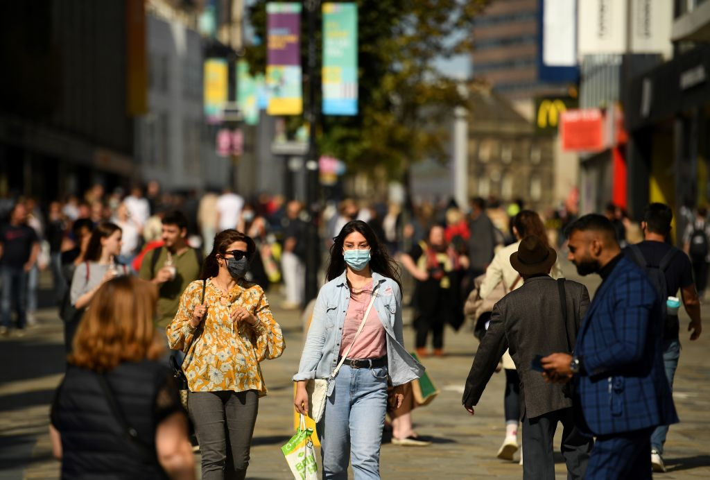 Shoppers, some wearing a face covering, walk in Newcastle city centre, north-east England, on September 17, 2020. (Photo: OLI SCARFF/AFP via Getty Images)